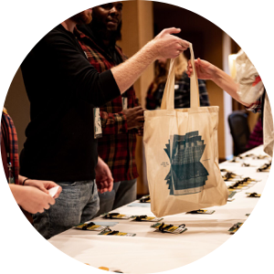 Registration table and swag bag at Design Camp 2019