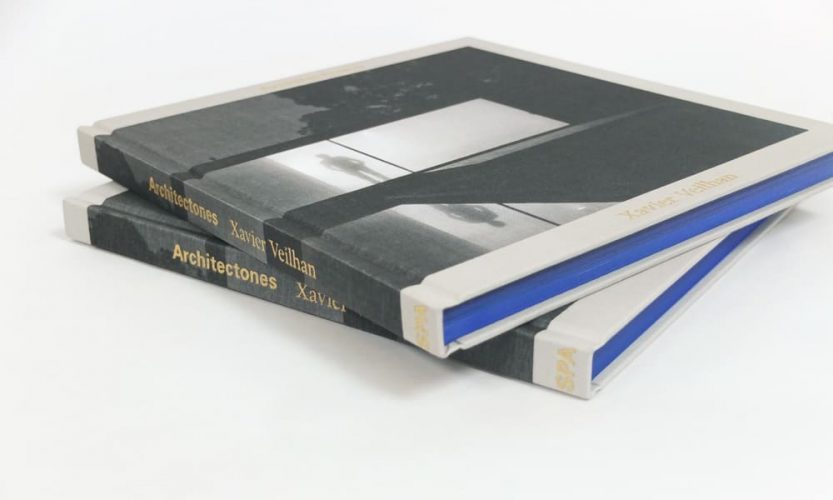 Two hardbound books with blue page edging